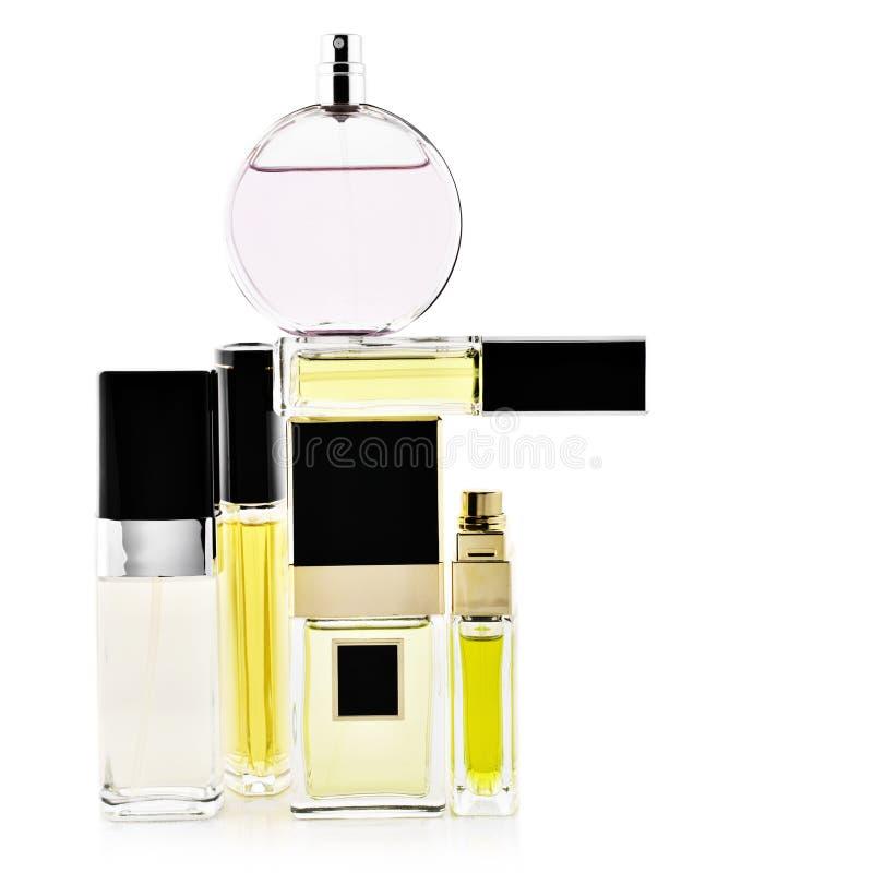 Perfumes ajustados no branco imagem de stock