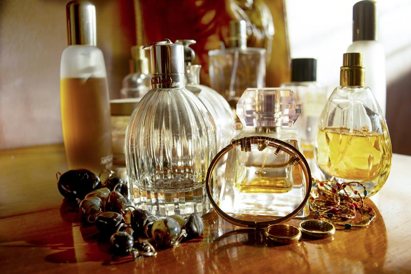 Perfumes and family jewels stock images