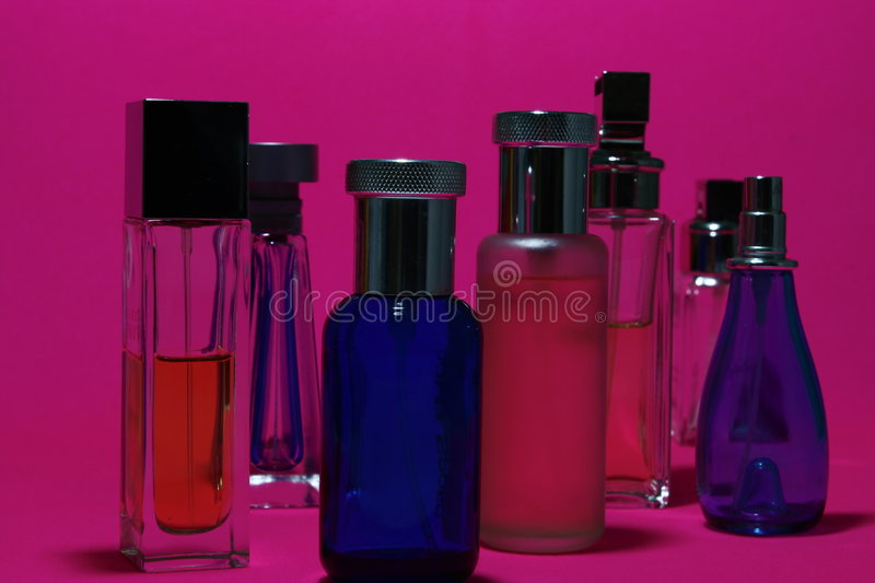 Perfumes and Fragrances Bottles. In red background stock image