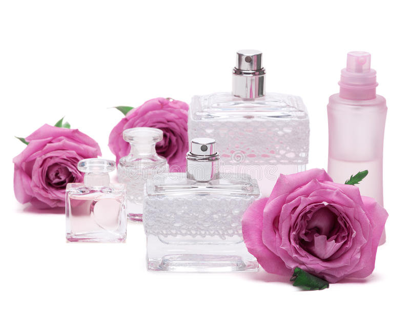 Perfumes with roses on white background. Various fragrances for women. Close-up of perfumes with roses on white background royalty free stock photo