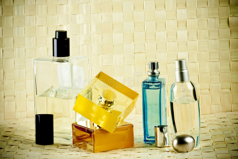 Perfumes set. Set of perfumes on bamboo mats royalty free stock images