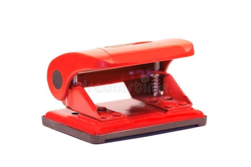 Perfurador vermelho do escritório fotografia de stock