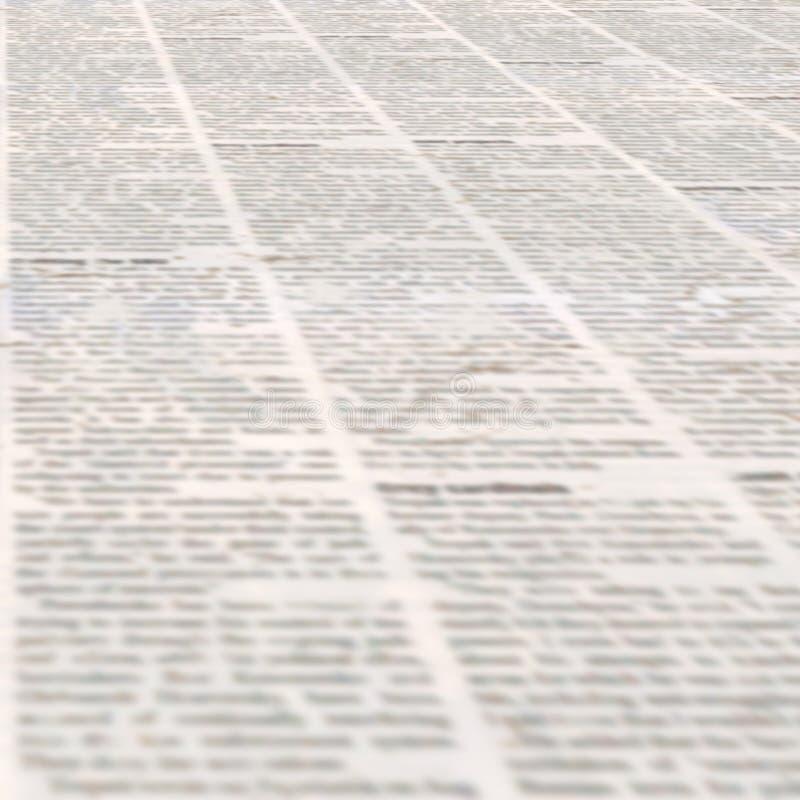 Periódico con el fondo de papel ilegible de la textura del viejo vintage foto de archivo