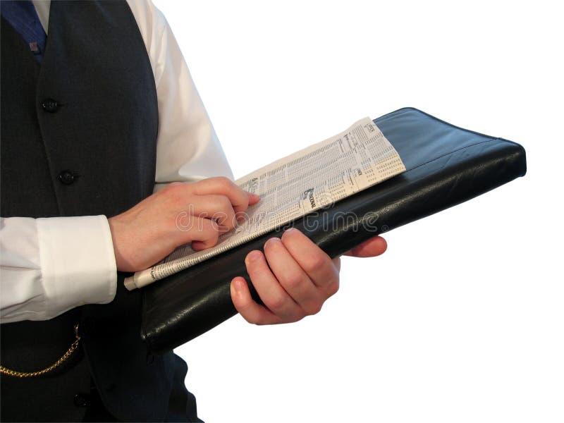 Periódico en la cartera imagen de archivo libre de regalías