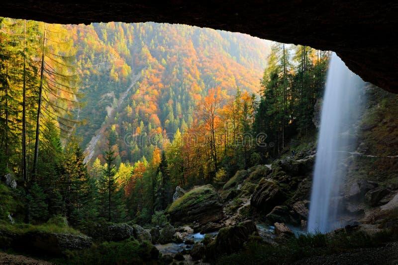 Pericnik Falls, waterfall with orange tree in Triglav National Park, Slovenia. Landscape in nature Europe. Foggy Triglav Alps stock images