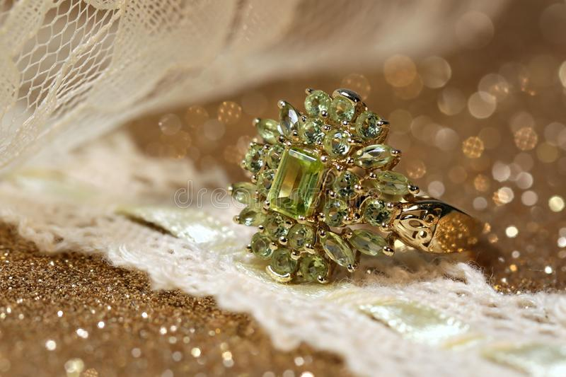 Peridot. Birthstone of August, peridot, in a gold ring setting stock photos