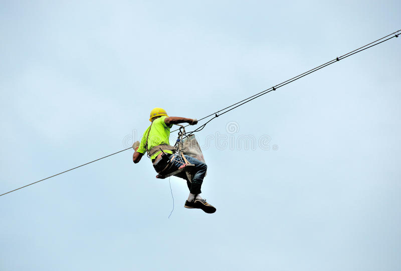 Perimeter electrician in laying cable stock images