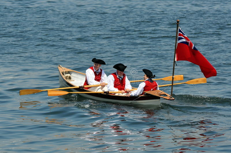 Period actors in rowboat, Colonial times stock images