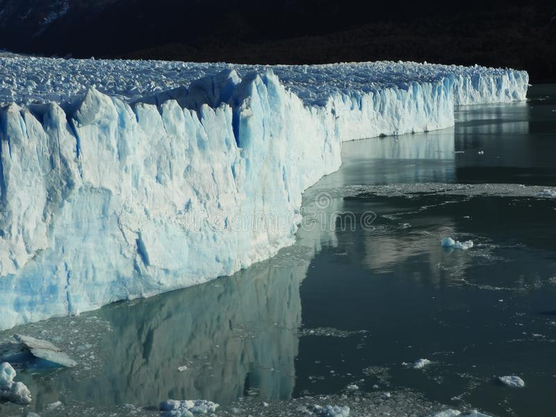 Perito moreno glacier calafate winter season vacations outdoors nature awe beauty landscape frozen lake snowy mountains. Patagonia, argentina, beautiful royalty free stock photo