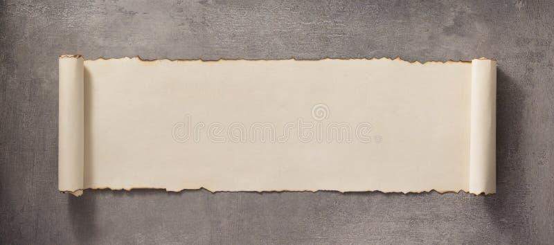 Perkamentrol aan concrete oppervlakte royalty-vrije stock foto