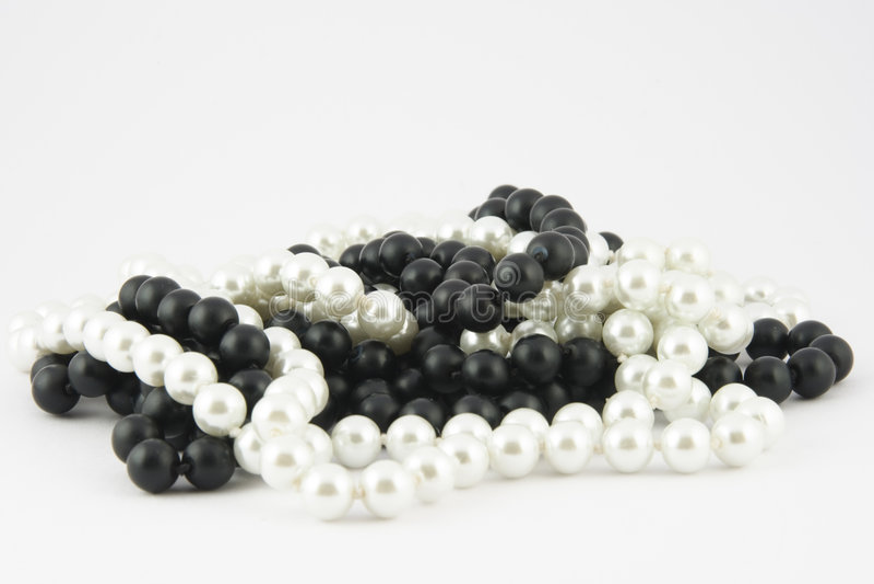 Perlas negras y blancas fotografía de archivo