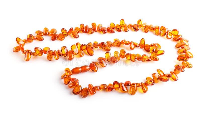 Perle ambrate arancio isolate su fondo bianco fotografia stock libera da diritti
