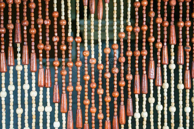 Perle di legno di forma e della dimensione differenti fotografia stock libera da diritti