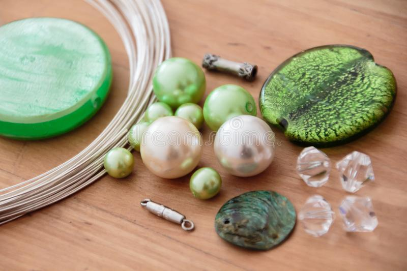 Beading set to make yourself. Green beading set to make yourself royalty free stock images
