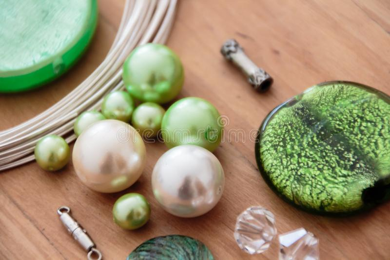 Beading set to make yourself. Green beading set to make yourself stock images