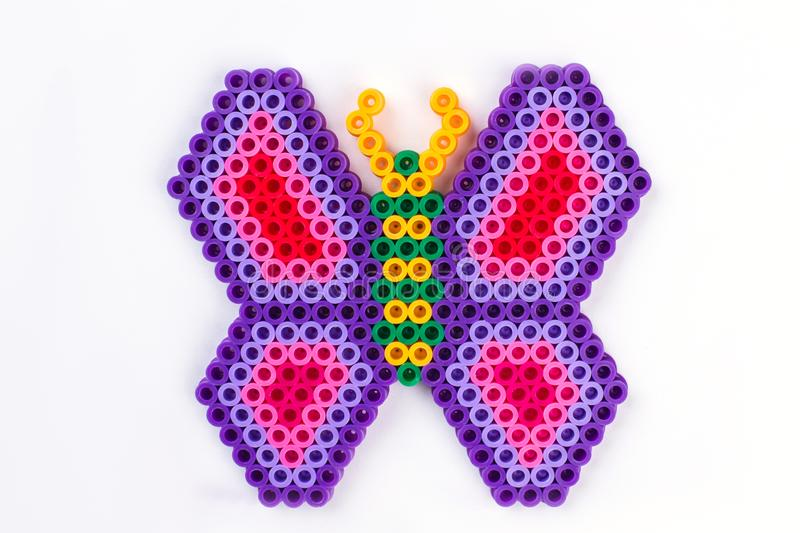 Perler bead butterfly. Close up. White isolated background royalty free stock photography