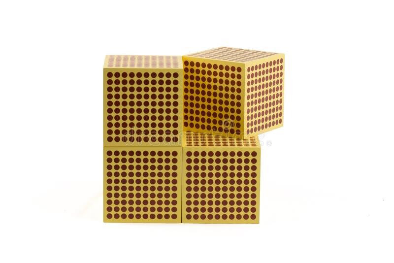 Perles d'or de Montessori - cube 1000 photographie stock