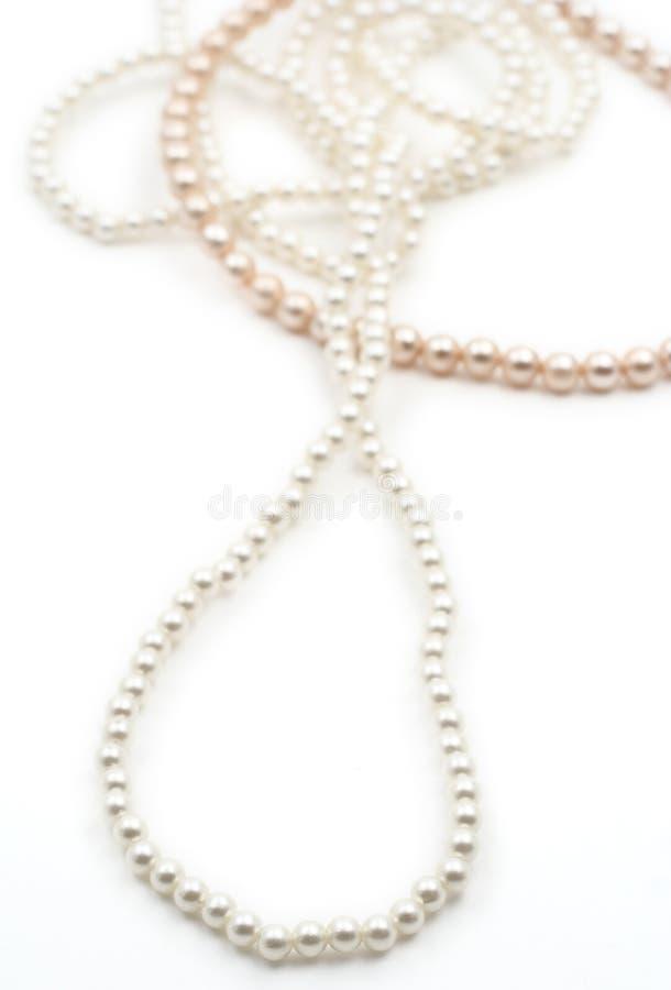 Perles sur le fond blanc image stock
