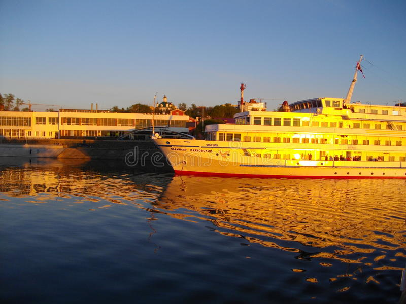 Perm. The river port at sunset. The River Kama. The `gold` ship `Vladimir Mayakovsky`. stock image