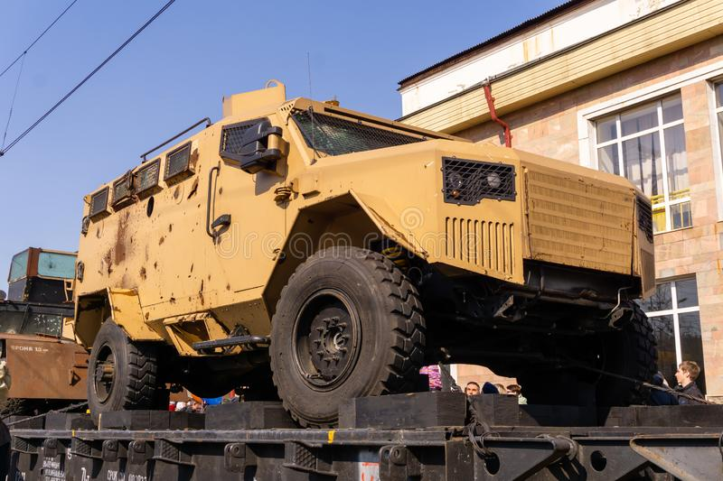 Armored car with holes in armor on the railway flatcar stock images