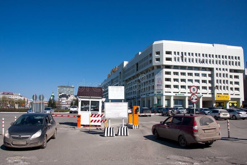 Perm, Russia - April 30.2016: Car parking near the hotel - Ural. Lenin Street royalty free stock photos