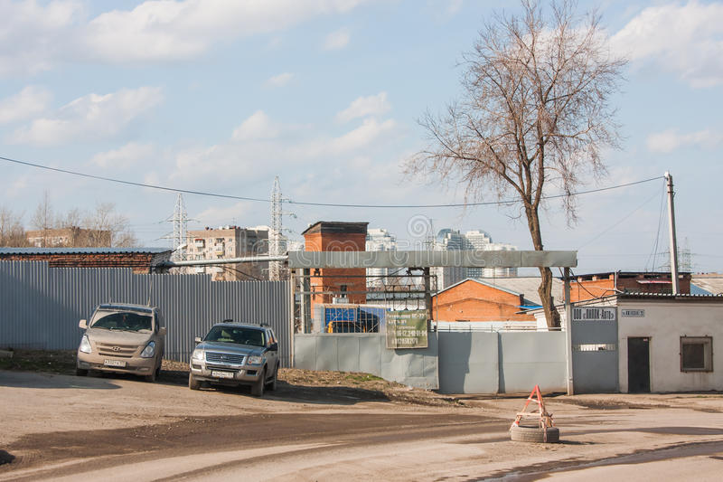 Perm, Russia - April 16,2016: Closed metal gate and cars. On a parking royalty free stock image