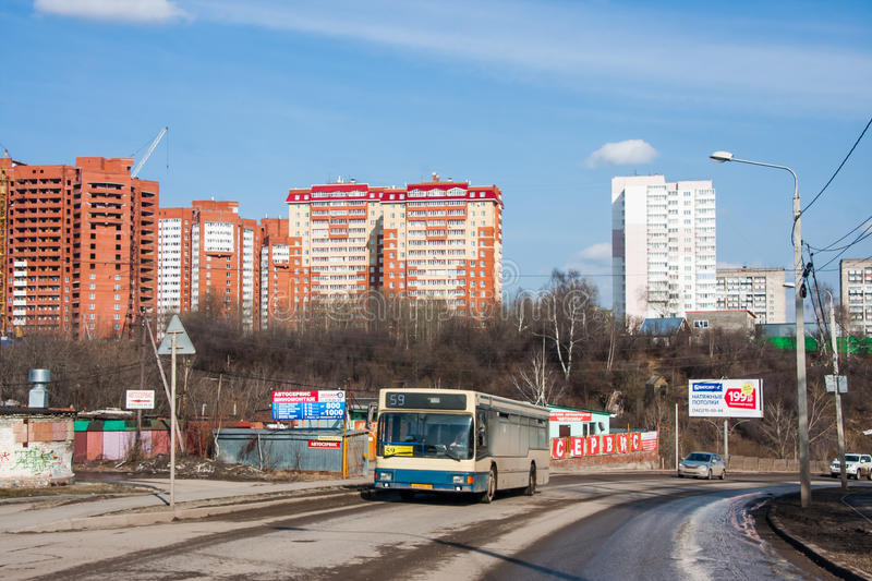 Perm, Russia - April 16. 2016: New residential complex `The Aviat. Or` and the bus goes on the road royalty free stock photo