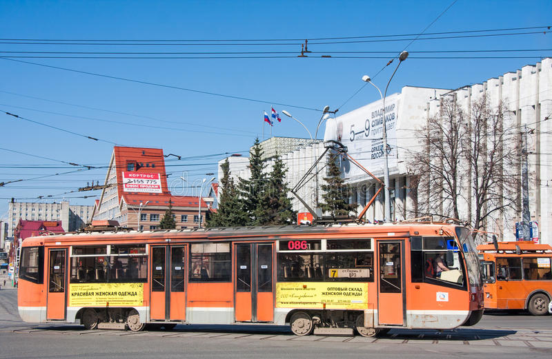Perm, Russia - April 30. 2016: Tram in the street Lenin. A city landscape stock image