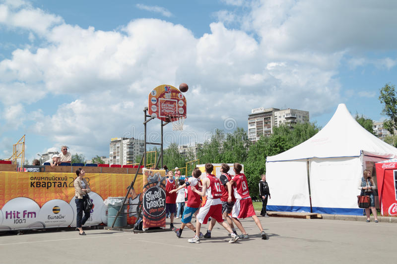 PERM, RUSSIA - JUN 13, 2013: Young people play at Youth Basketball Tournament at festival White Nights. stock image
