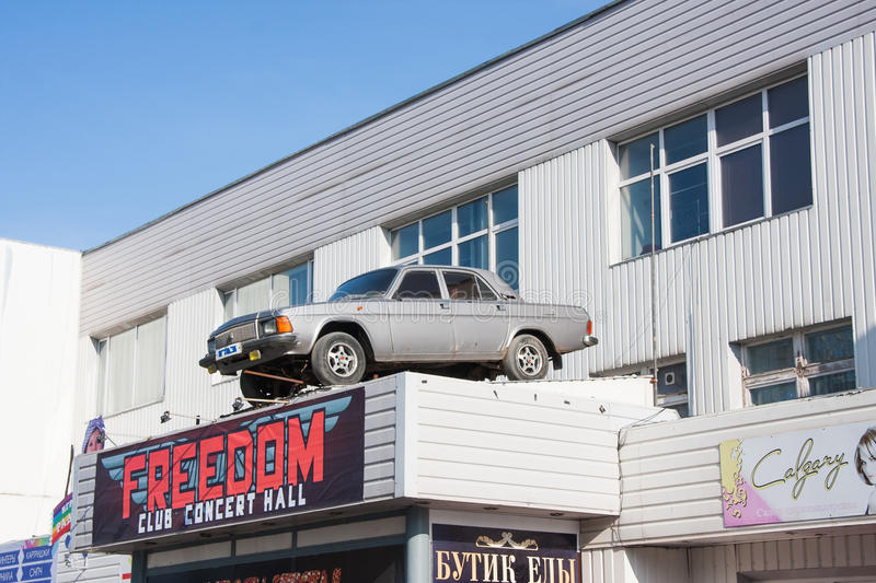 Perm, Russia - March 31.2016: Car `Volga` on the roof of the sho. Pping center building stock image
