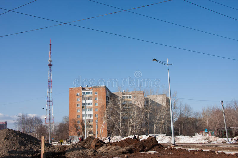 Perm, Russia - March 31.2016: City landscape with dirty roads. Perm, Russia - March 31.2016: City spring landscape with dirty roads stock image