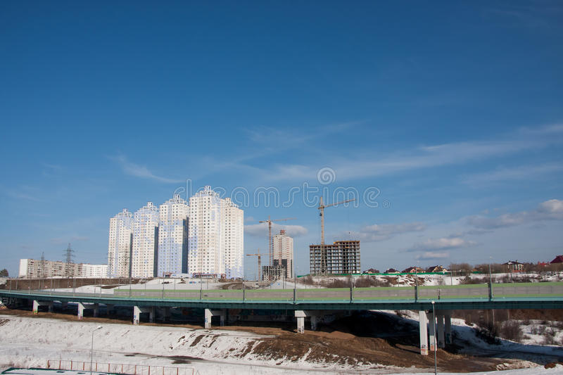 Perm, Russia - March 31.2016: Construction of a new inhabited co. Mplex and the automobile bridge royalty free stock images