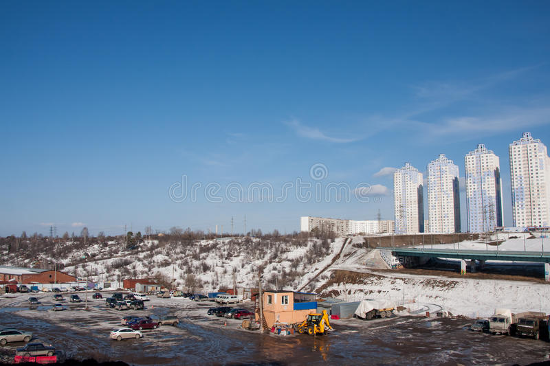 Perm, Russia - March 31.2016: Construction of a new inhabited co. Mplex and the automobile bridge royalty free stock photography