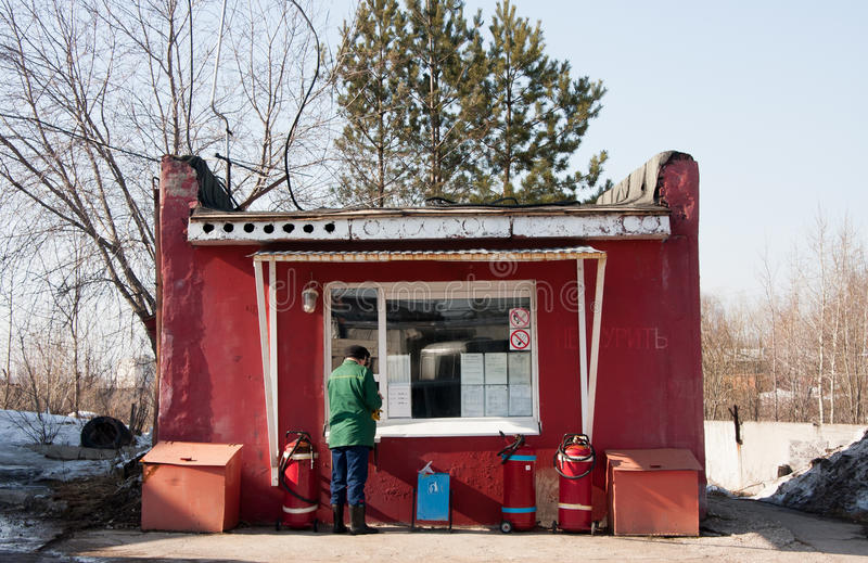 Perm, Russia - March 31.2016: Man pays for a diesel car. On a filling station stock photography