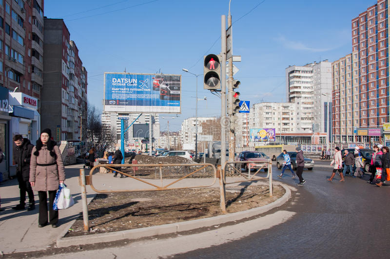 Perm, Russia - March 31,2016: People pass road on a pedestrian c. Rossing to a green signal of a traffic light stock photo
