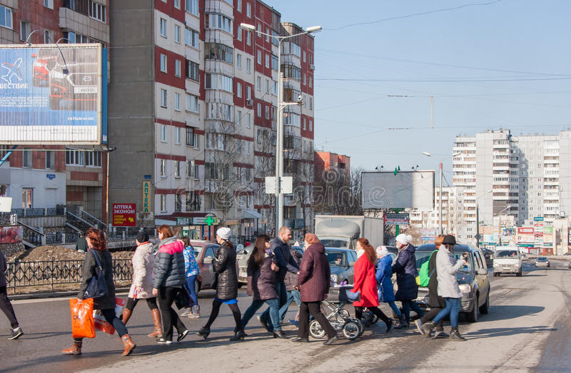 Perm, Russia - March 31,2016: People pass road on a pedestrian c. Rossing to a green signal of a traffic light royalty free stock photography