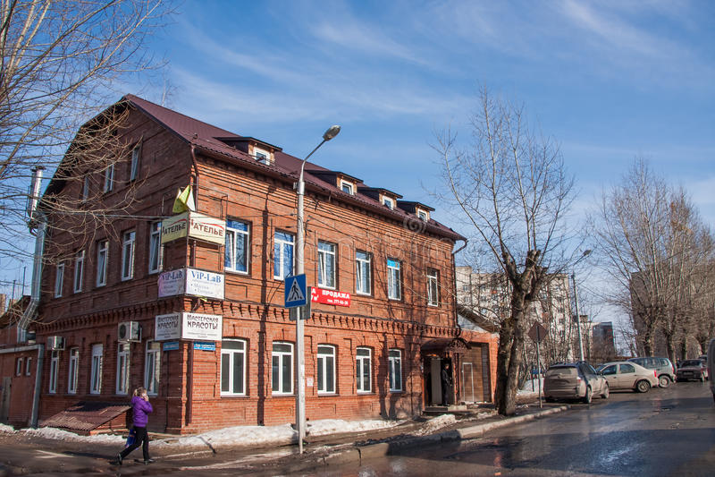 Perm, Russia - March 31.2016: Spring cityscape with a brick house. And blue sky stock images