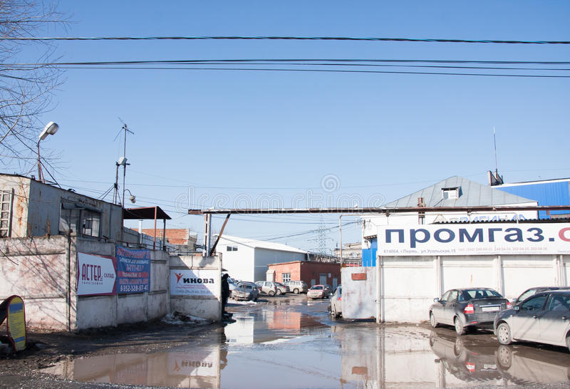 Perm, Russia - March 31.2016: Trading the base of building mater. Ials and cars near the gate stock photo