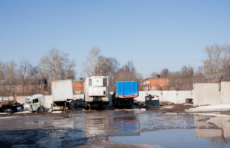 Perm, Russia - March 31.2016: Trailers of supersize cars on park. Ing in the transport company royalty free stock image