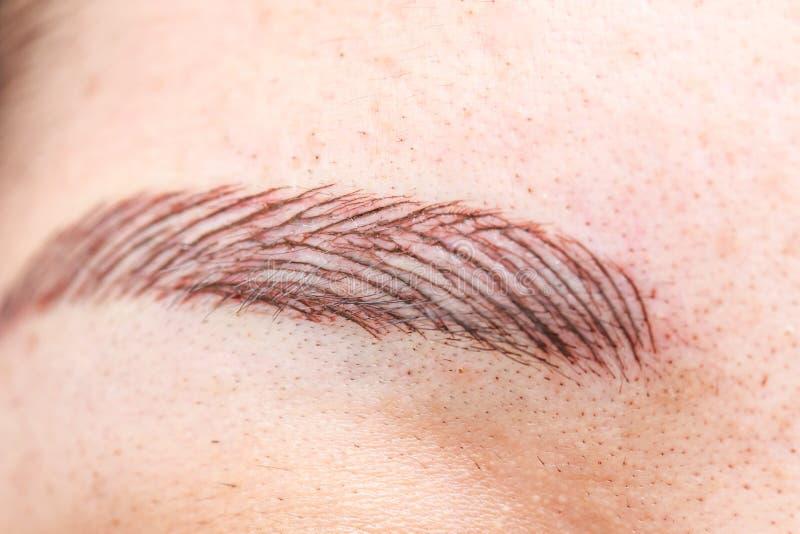 Permanent ögonbryntatuering arkivfoton