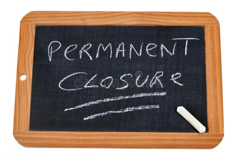 Permanent closure written on a school slate. Closing warning written on a school slate royalty free illustration