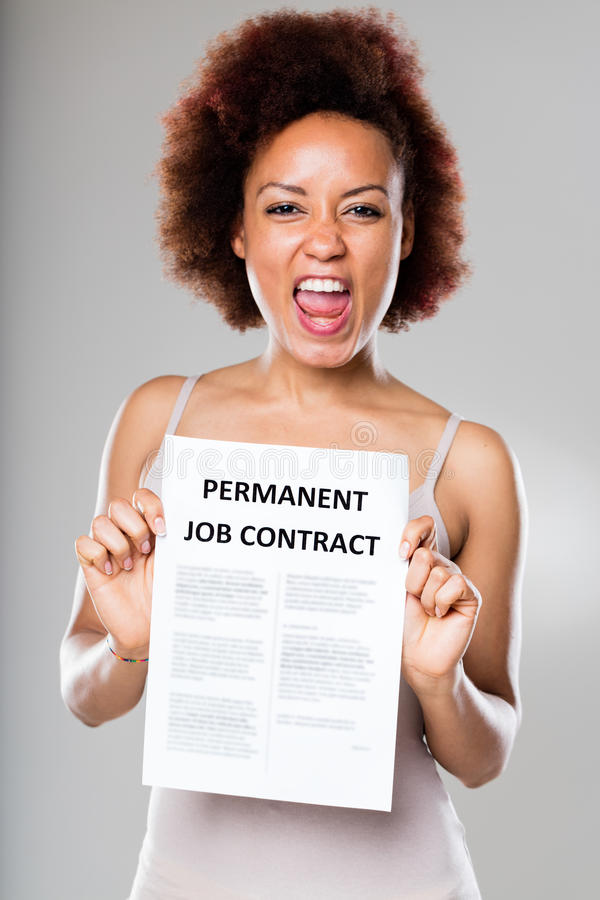 Permanent job contract is not for everyone. Young woman happy because of her permanent job contract royalty free stock photo