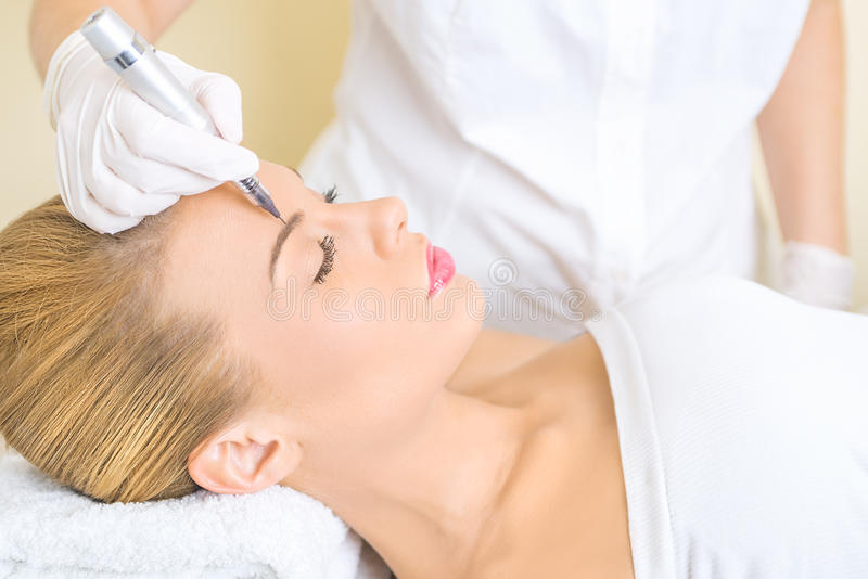 Permanent make up on eyebrows royalty free stock image