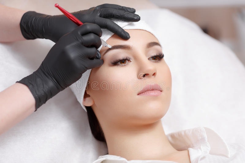 Permanent makeup eyebrows. royalty free stock image