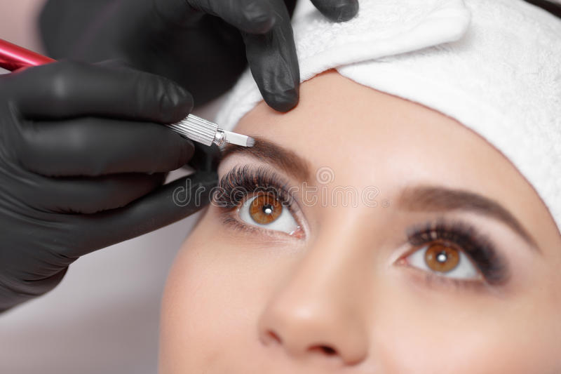 Permanent makeup eyebrows. stock image