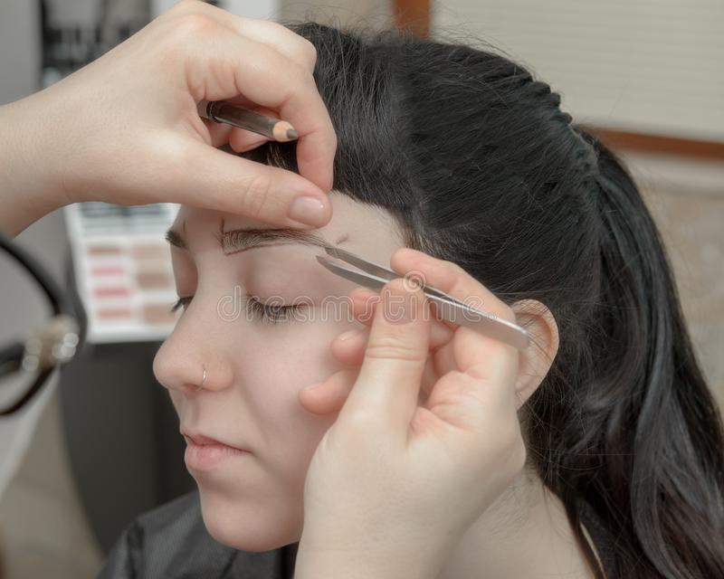 Permanent makeup. Permanent tattooing of eyebrows stock photos