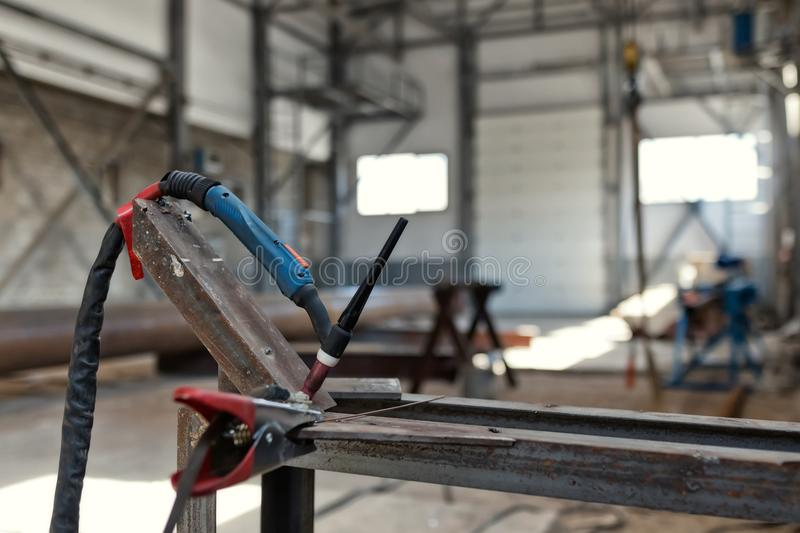 Permanent place of welding argon-arc weld. Ing in a small industrial shop. Equipment, burner and accessories for welding royalty free stock photography