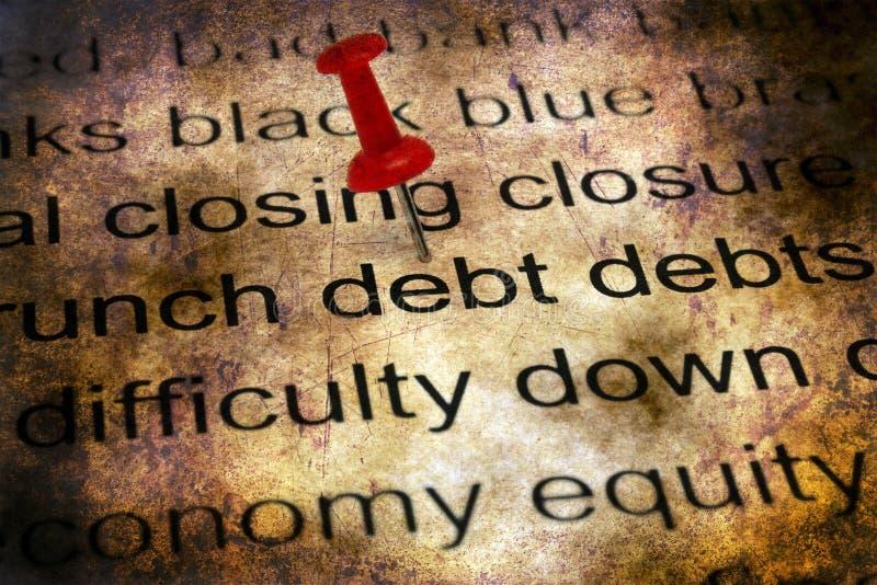 Perno di spinta sul concetto di debito fotografie stock