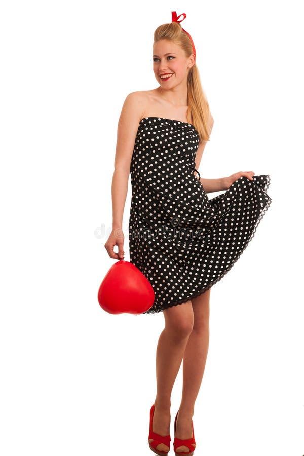 Perno retro del estilo encima de la muchacha con el pelo rubio en vestido negro con whi fotografía de archivo
