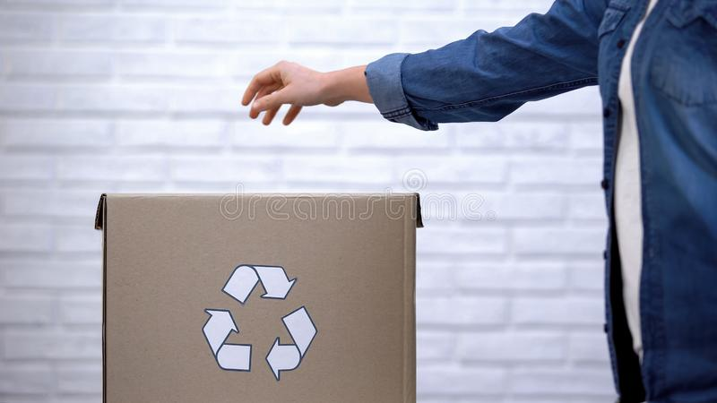 Peron throwing litter into trash bin, waste sorting concept, recycling system. Stock photo stock photos